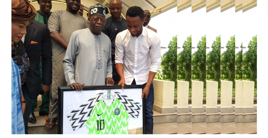MIKEL OBI PRESENTS WORLD CUP SHIRT TO ASIWAJU TINUBU