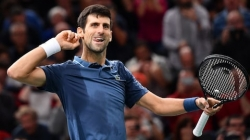 DJOKOVIC OUTLASTS ROGER FEDERER TO REACH PARIS MASTERS FINAL