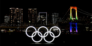 WITH FIREWORKS AND RINGS MONUMENT LIGHTING, TOKYO MARKS SIX MONTHS TO OLYMPIC GAMES