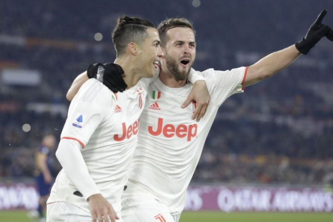 RONALDO STRIKES JUVENTUS TO SERIE A TOP POSITION