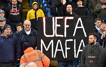 MANCHESTER CITY FANS BRAND UEFA AS MAFIA AND CARTEL