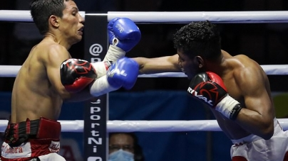 'BOXERS NEED TO EAT': CONTROVERSIAL BOUT HELD AS FIGHTERS ARE SPRAYED WITH DISINFECTANT